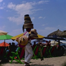 The hat vendor and his balancing act.